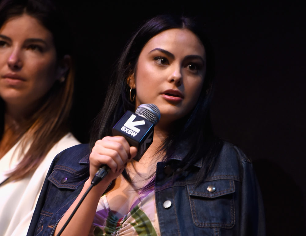 """AUSTIN, TX - MARCH 11: Actor Camila Mendes speaks onstage at the premiere of """"The New Romantic"""" during SXSW at Stateside Theater on March 11, 2018 in Austin, Texas."""