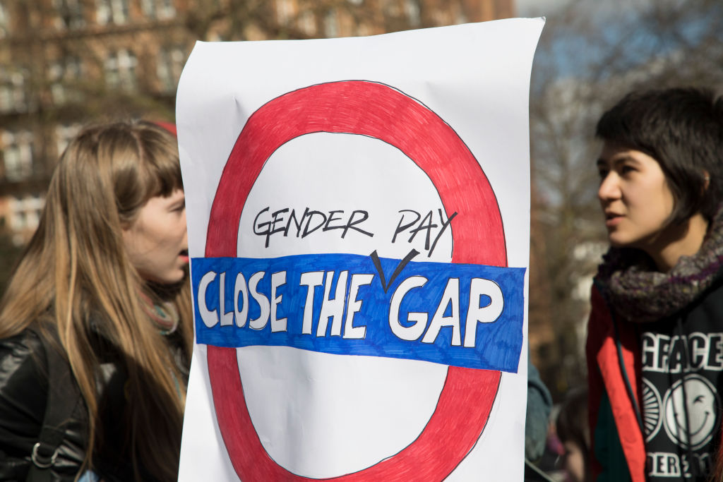 Hundreds of women gather in Russell Square for the Women's Strike Assembly on International Women's Day on 8th March 2018 in London, England, United Kingdom. International Women's Day is celebrated on March 8 every year. It commemorates the movement for women's rights, and for all women to stand together in solidarity over women's issues. (photo by Mike Kemp/In Pictures via Getty Images)