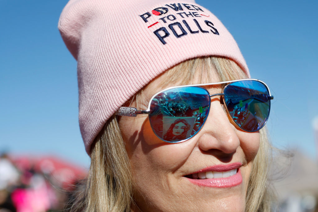 """LAS VEGAS, NV - JANUARY 21: Carol Barber Terkhorn waits for the start of the Women's March """"Power to the Polls"""" voter registration tour launch at Sam Boyd Stadium on January 21, 2018, in Las Vegas, Nevada. Demonstrators across the nation gathered over the weekend, one year after the historic Women's March on Washington, D.C., to protest President Donald Trump's administration and to raise awareness for women's issues. (Photo by Sam Morris/Getty Images)"""