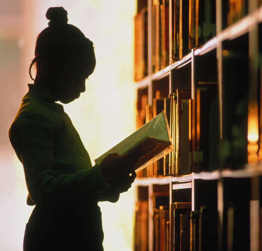 Silhouette of girl in library