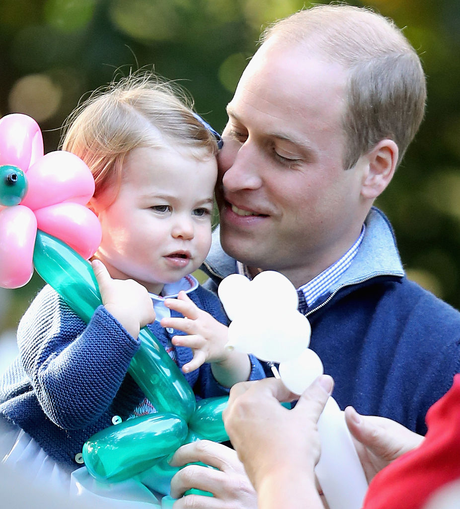 Princess Charlotte with her dad.