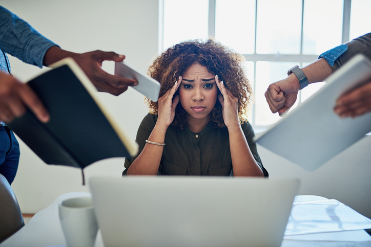 Woman stressed at her job