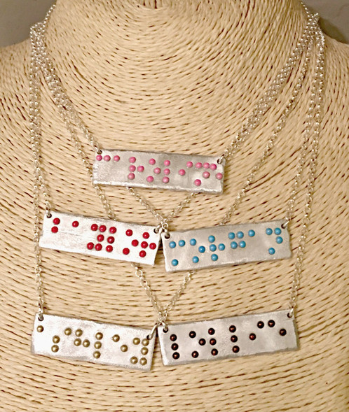 Patti-Ricky-braille-necklace.jpg