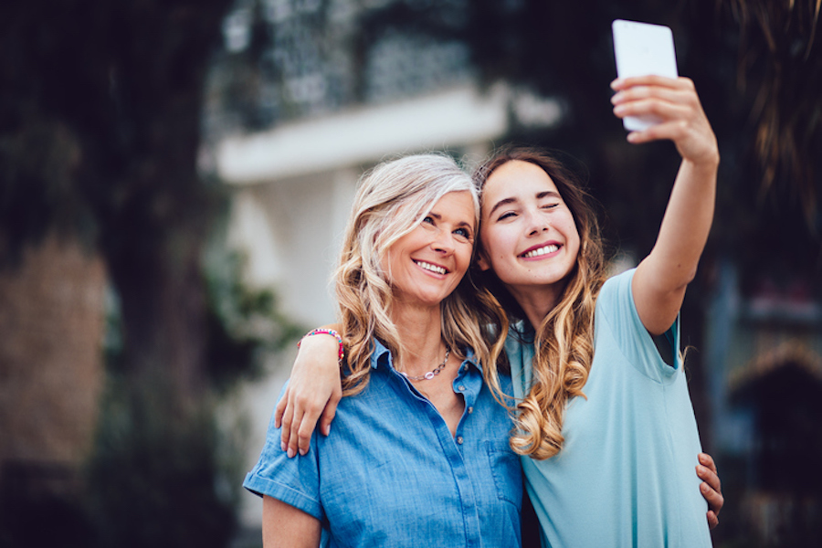 Mom and daughter taking selfie together