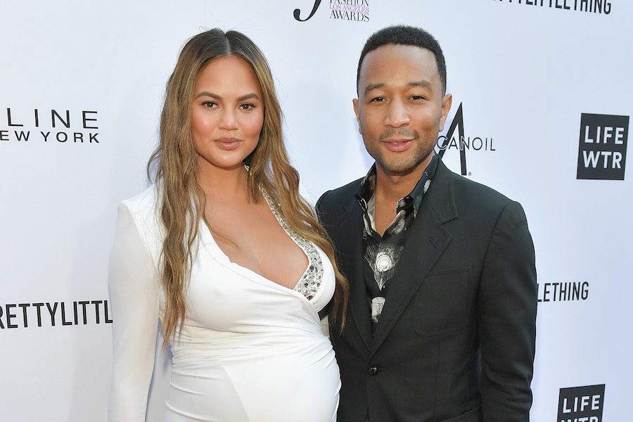 Chrissy Teigen and John Legend at The Daily Front Row fashion show