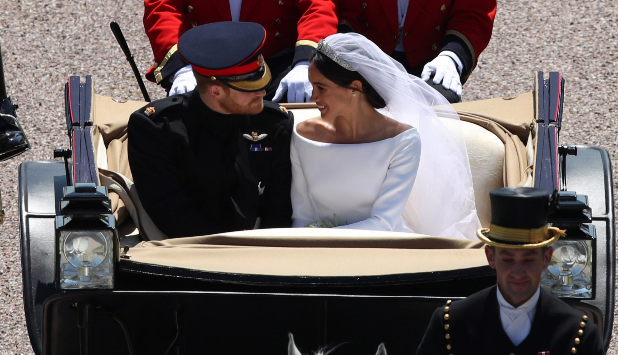 WINDSOR, ENGLAND - MAY 19:  Prince Harry, Duke of Sussex and The Duchess of Sussex leave Windsor Castle in the Ascot Landau carriage during a procession after getting married at St Georges Chapel on May 19, 2018 in Windsor, England.  (Photo by Yui Mok - WPA/Getty Images)