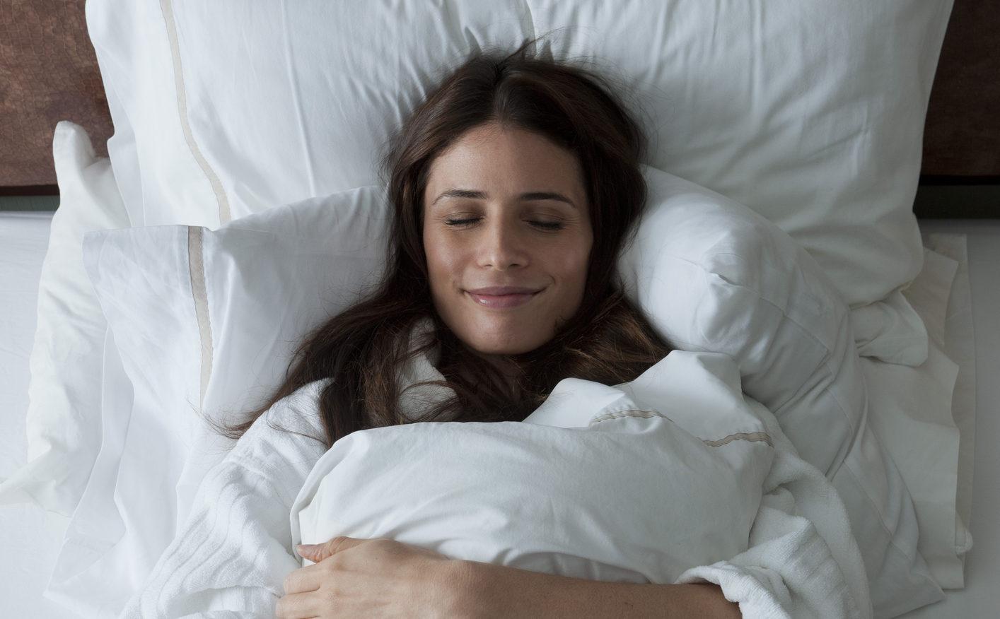 Woman enjoying her comfortable bed
