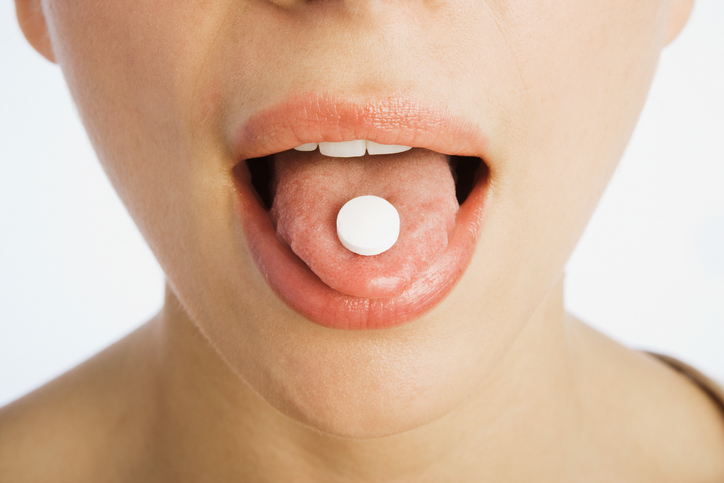 Pill on a tongue