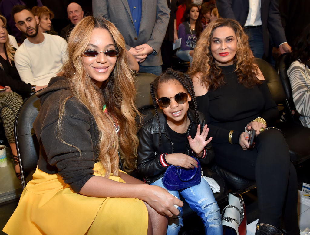 LOS ANGELES, CA - FEBRUARY 18: (L-R) Beyonce, Blue Ivy Carter, and Tina Knowles attend the 67th NBA All-Star Game: Team LeBron Vs. Team Stephen at Staples Center on February 18, 2018 in Los Angeles, California.