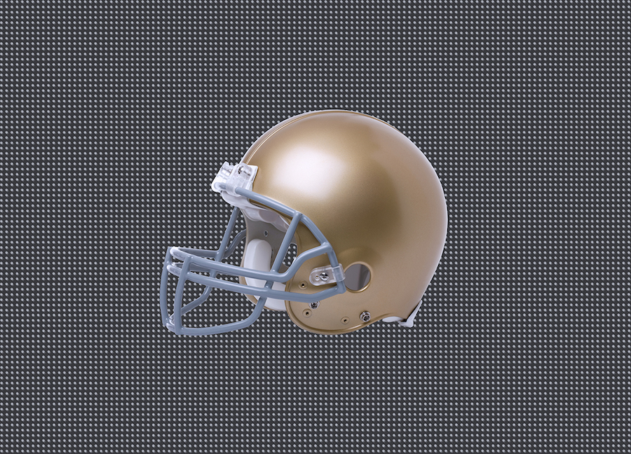 Gold football helmet on a black and white background
