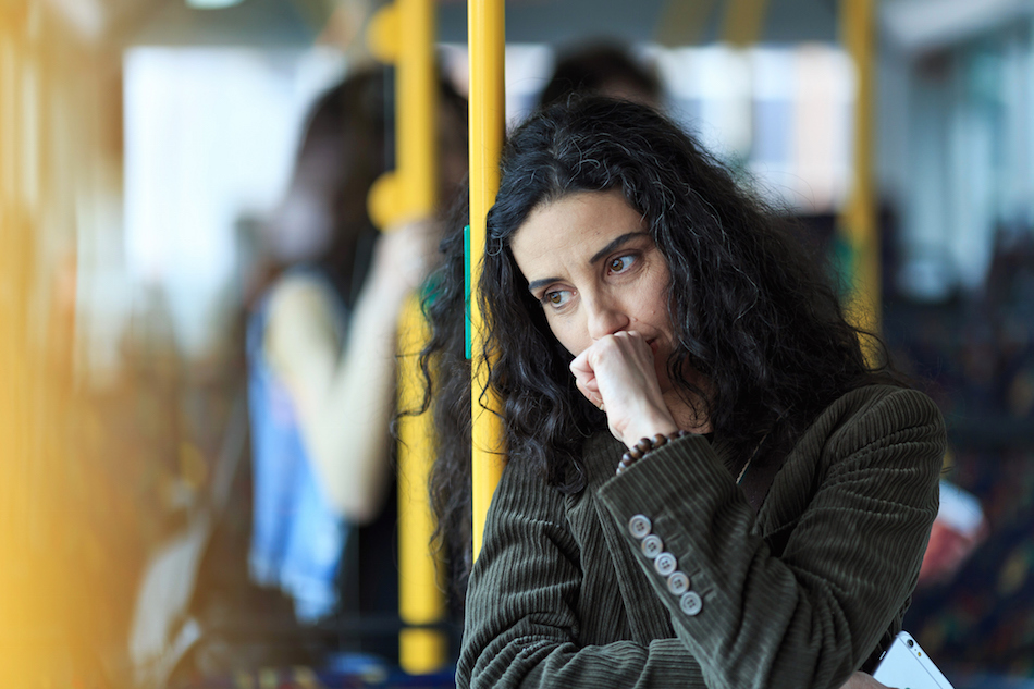 Anxious-looking woman traveling on the bus