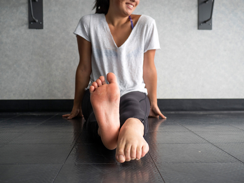Woman sitting on a yoga mat