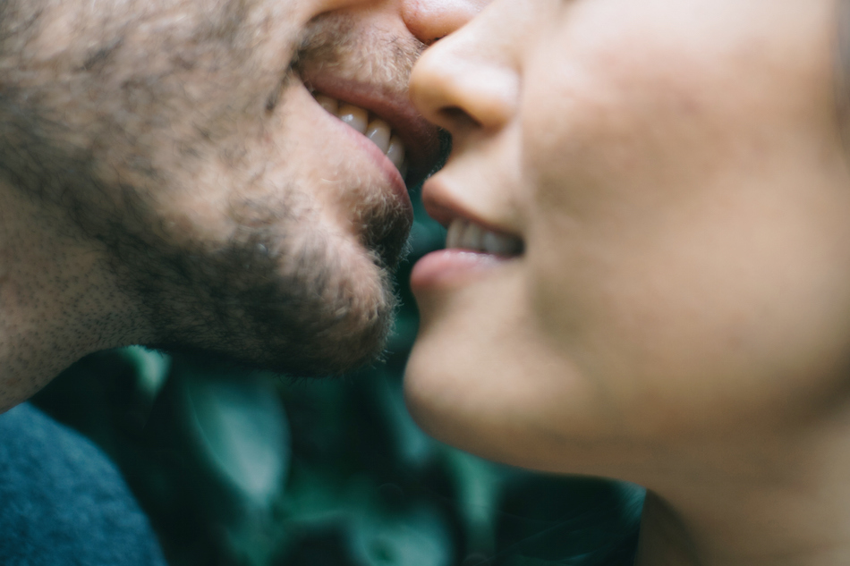 Closeup of a man and woman's mouths about to kiss