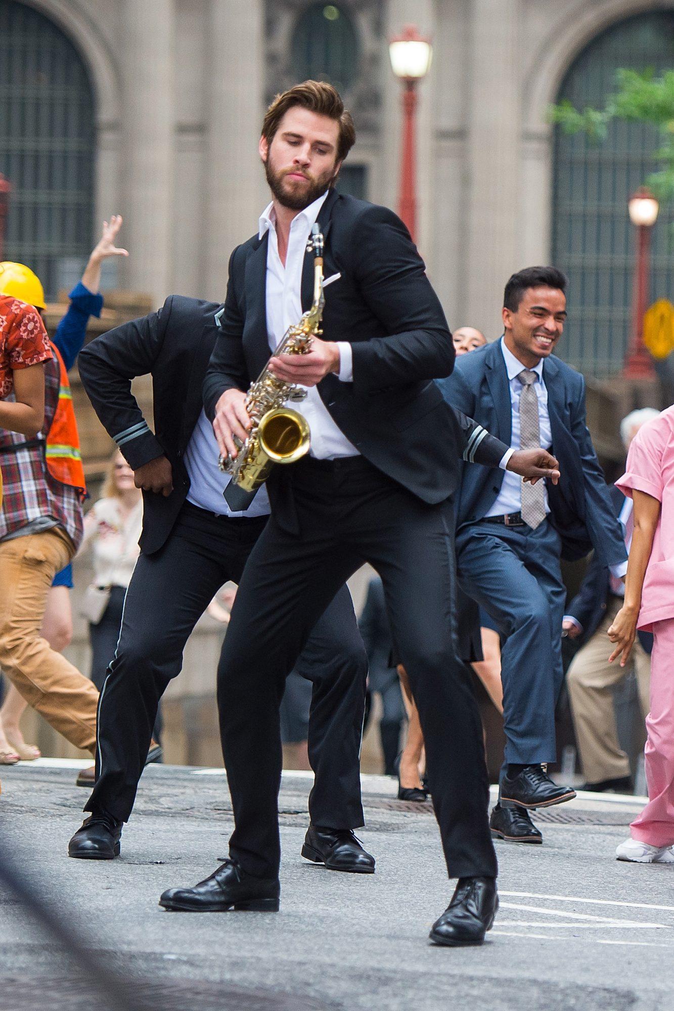 liam-hemsworth-saxophone-isnt-it-romantic.jpg
