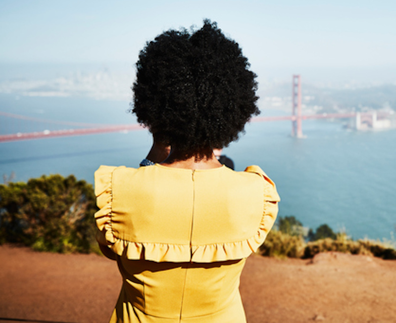 Rear image of woman looking at Golden Gate Bridge