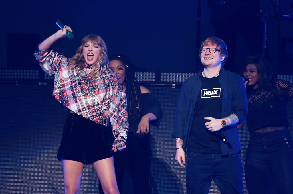 SAN JOSE, CA - DECEMBER 02: Ed Sheeran joins Taylor Swift onstage during the 99.7 NOW! POPTOPIA at SAP Center on December 2, 2017 in San Jose, California.