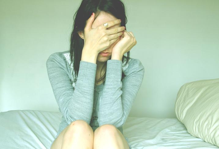 sad-woman-bed.jpg