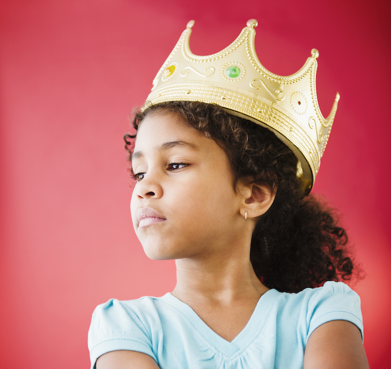 Girl wearing a play crown