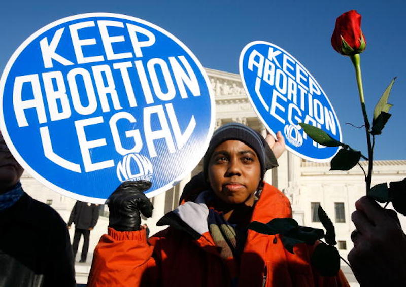 Pro-choice activist Lisa King protests in front of the Supreme Court.