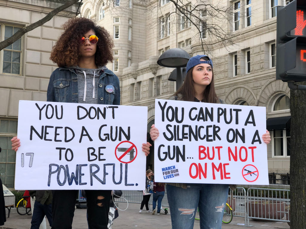 WASHINGTON DC, USA. MARCH 24 2018. Over 750,000 people gathered on Pennsylvania Avenue in Washington DC to protest lawmakers and politicians for change in gun laws. Many of those protesting were students including some some teachers, students and parents from Parkland, Florida. Students also spoke on a stage to rally protestors toward change in future voting. Photo by Giles Clarke/Getty Images