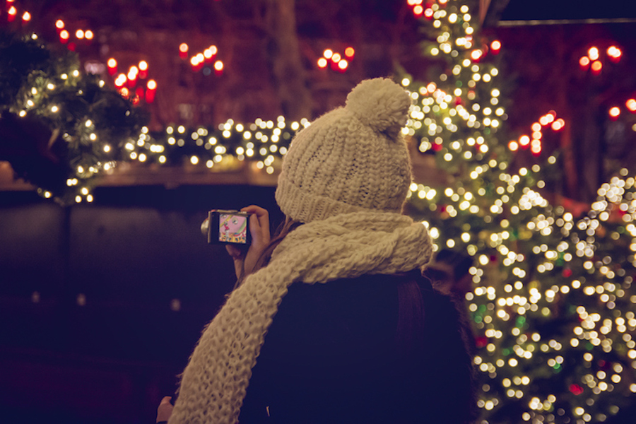 Woman in front of Christmas lights