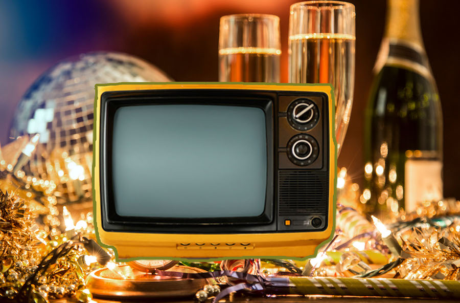 Vintage TV set on top of New Year's Ever party decorations