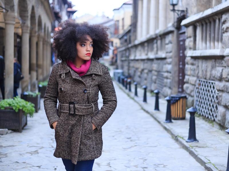 Woman walking down the street alone