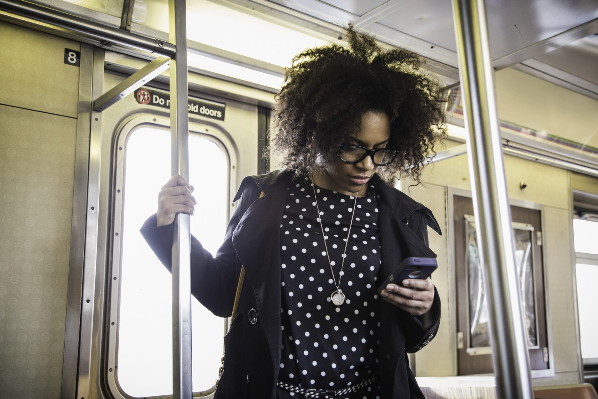 young black woman on the subway