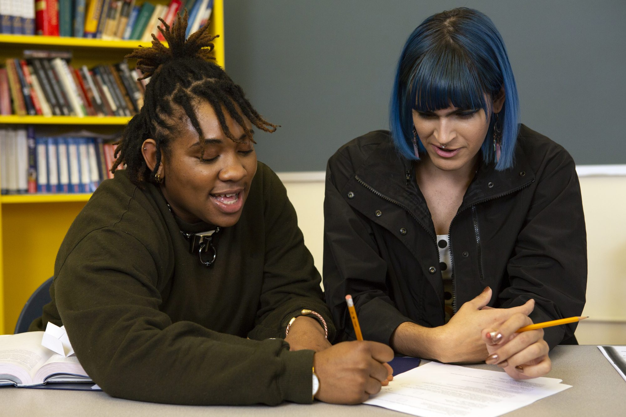 Two-non-binary-students-doing-work-together-in-class.jpg
