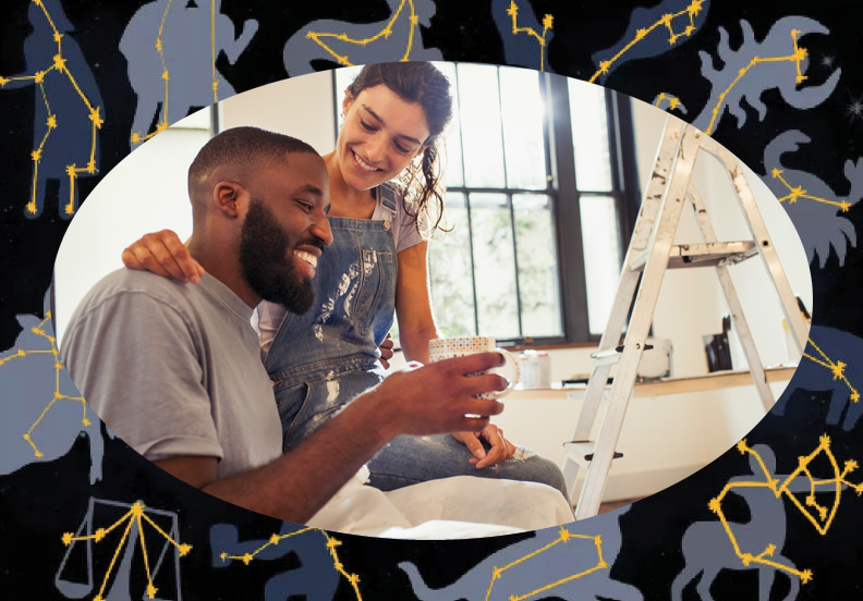 young mixed race couple painting a room