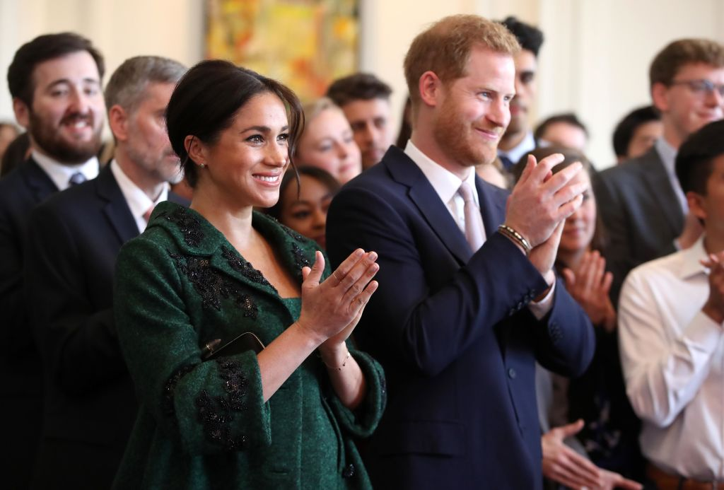 Meghan, Duchess of Sussex and Prince Harry, Duke of Sussex watch a musical performance as they attend a Commonwealth Day Youth Event at Canada House