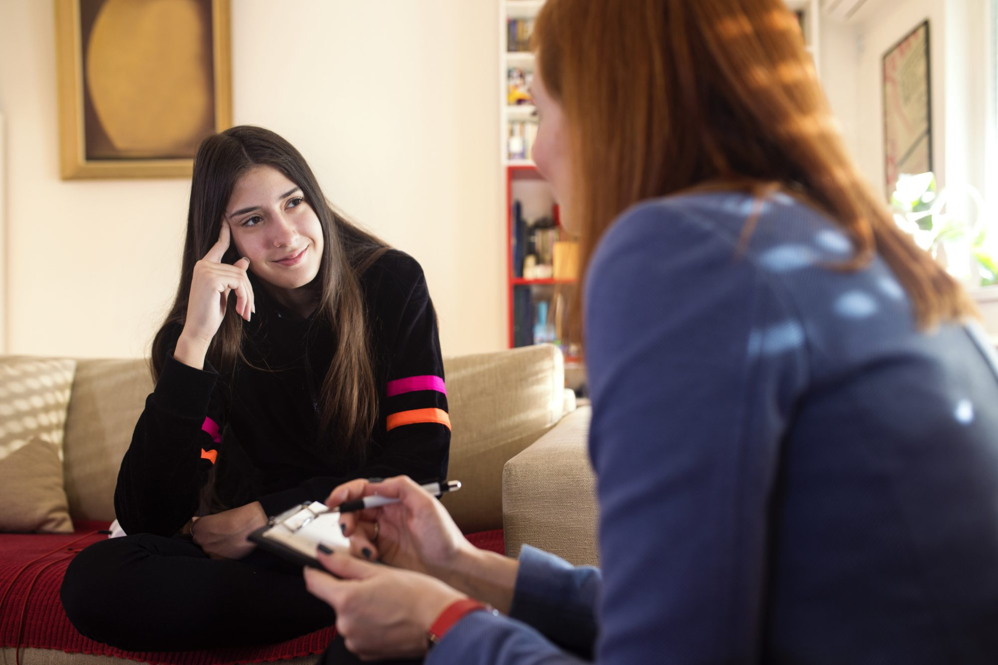 young woman talking to therapist