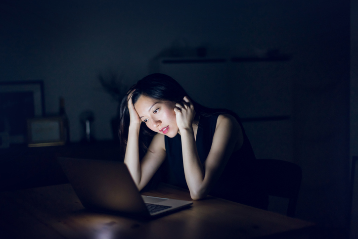 Stressed woman looking at laptop
