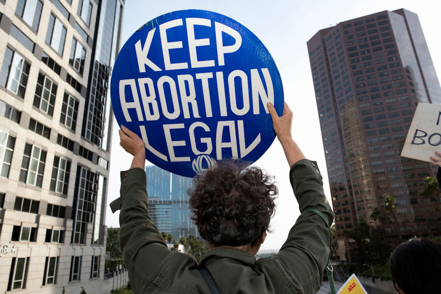 "Protester holding ""Keep Abortion Legal"" sign at ban protest in Los Angeles"