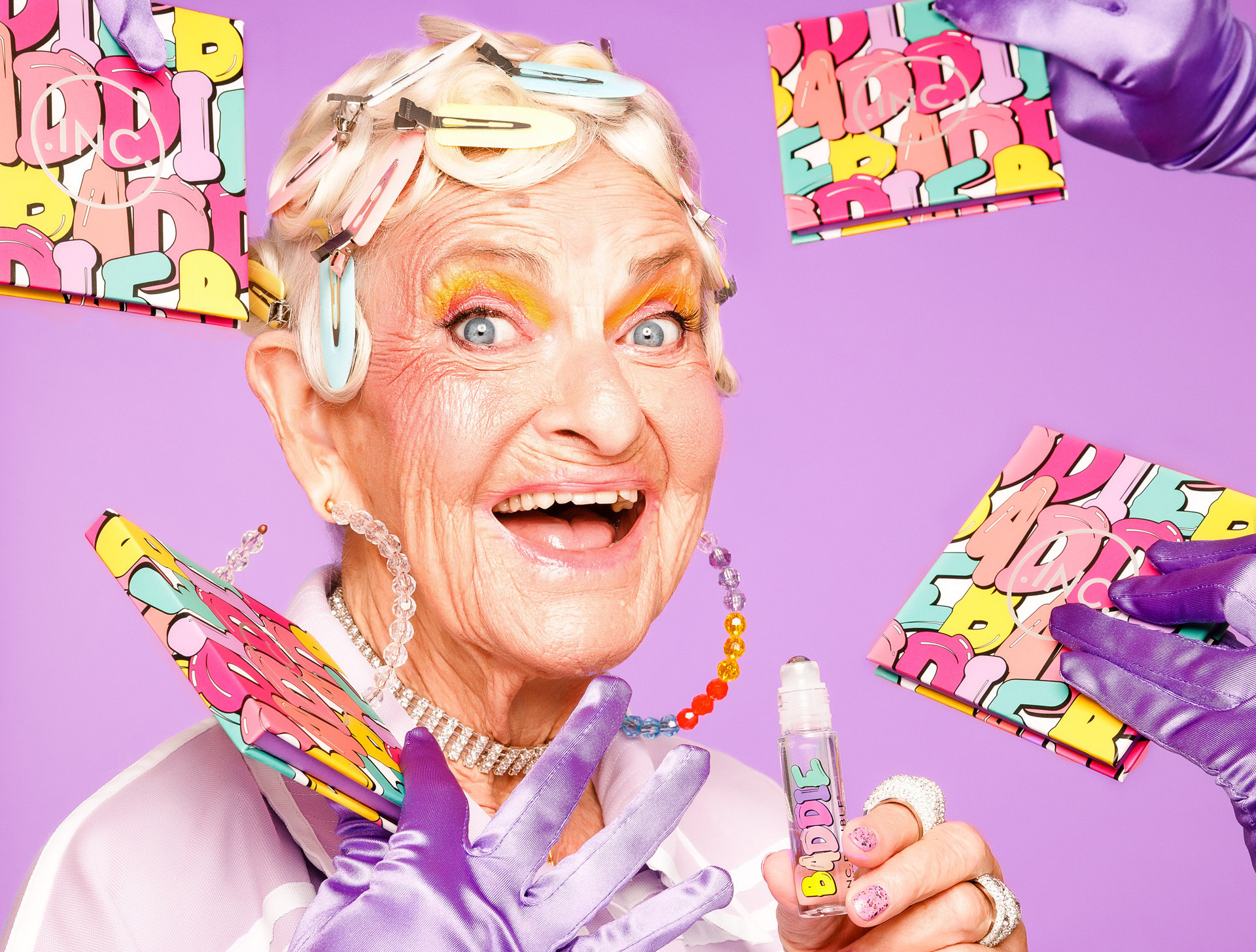 Baddie Winkle posing with her new makeup collection