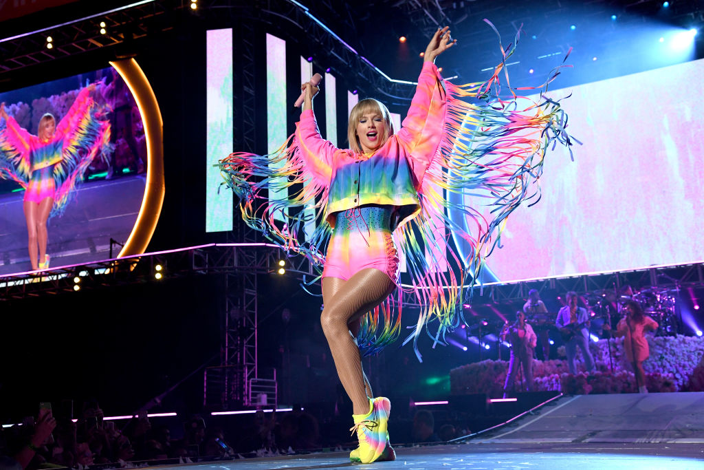 Taylor Swift performs at Wango Tango wearing a rainbow outfit