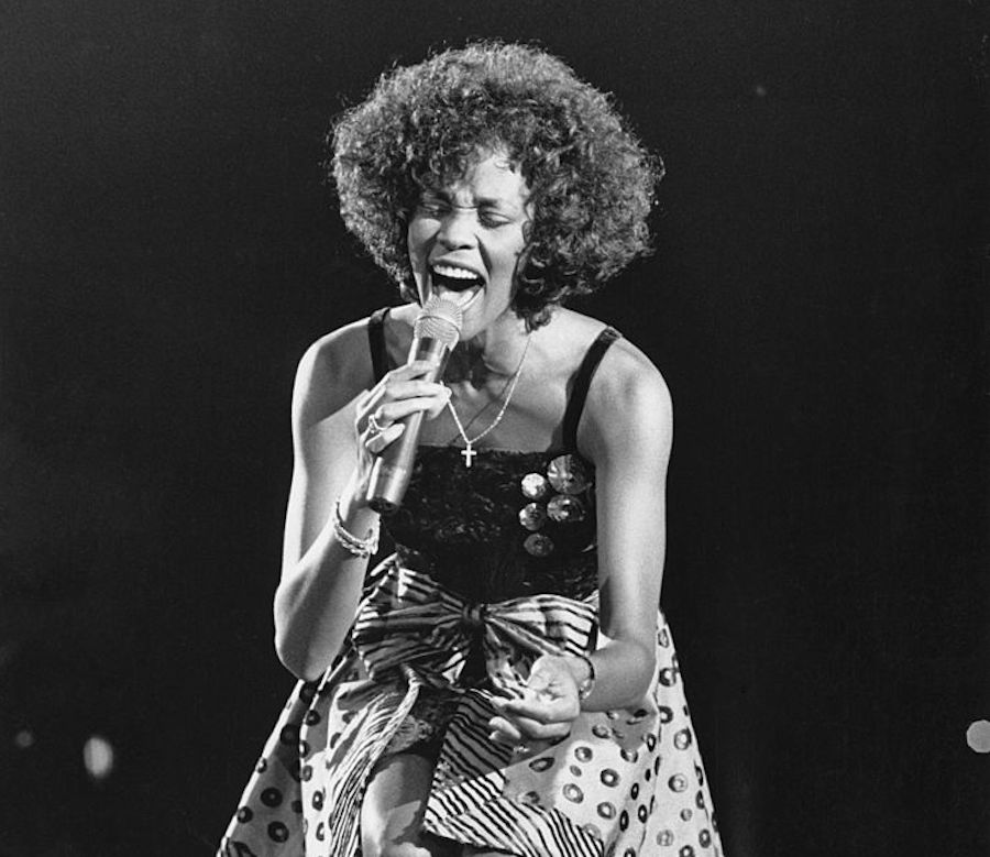 Whitney Houston performing on stage in 1988