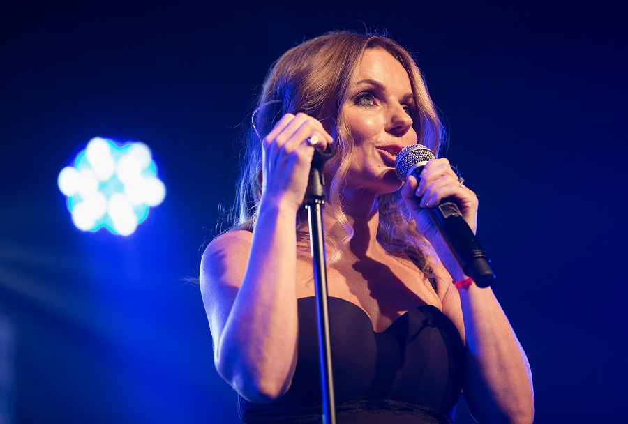 Geri Horner, Ginger Spice, performs on Spice Girls tour