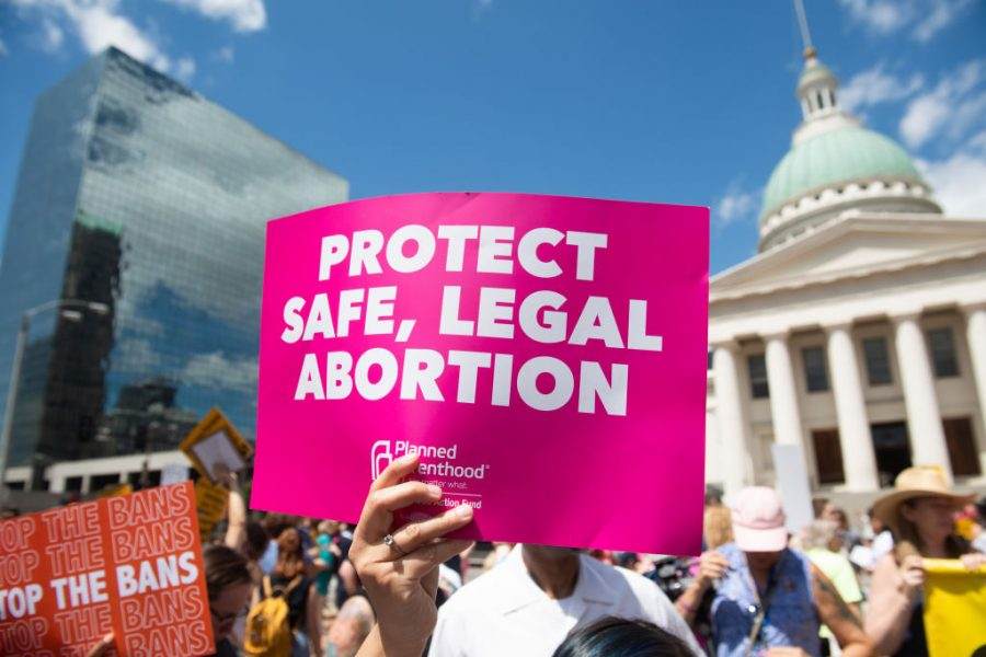 "Sign at Planned Parenthood rally reading, ""Protect Safe, Legal Abortion"""