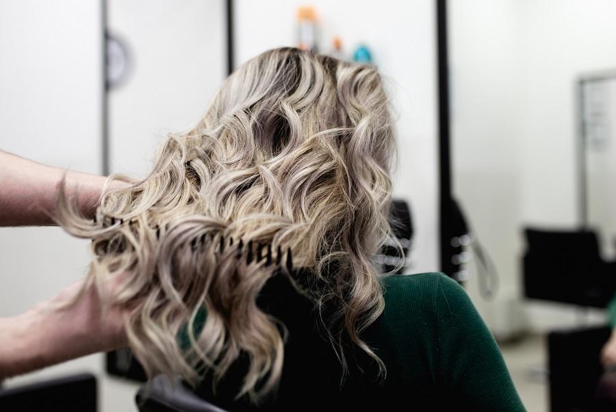 woman at a salon with mushroom blonde hair dye