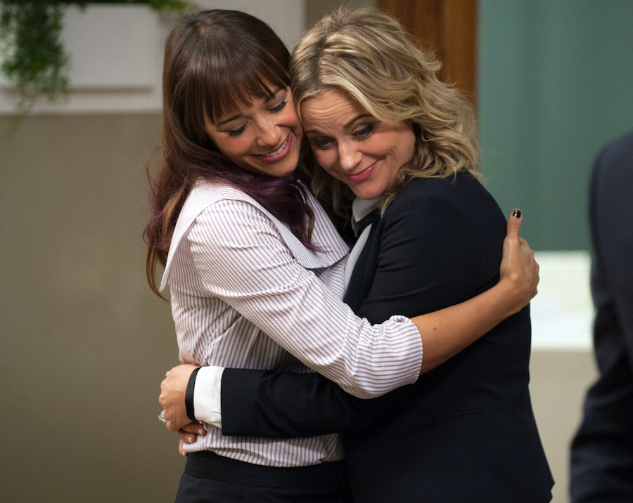 Leslie and Ann hugging in a scene from Parks and Recreation