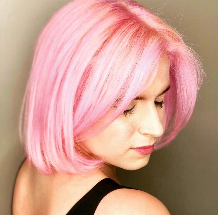 Author with pink hair