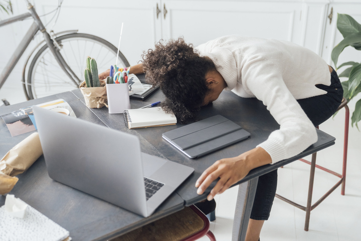 Woman falling asleep at her laptop