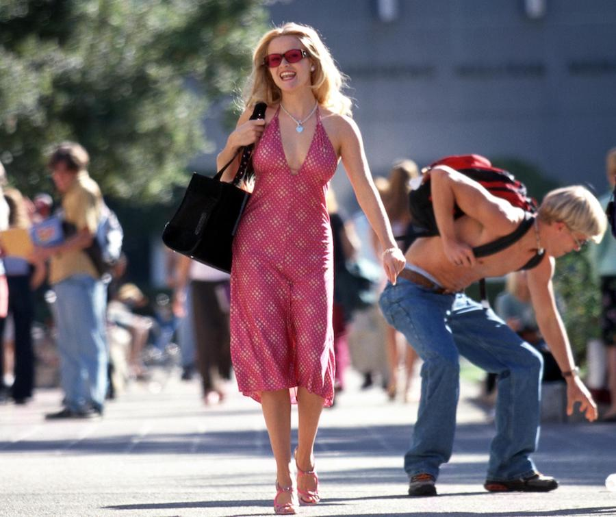 Reese Witherspoon as Elle Woods in Legally Blonde, walking across college campus