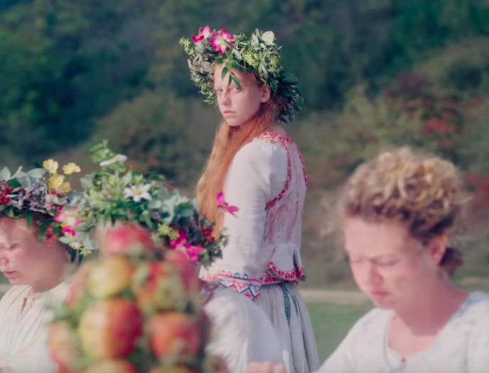 Scene of woman in cult from Midsommar