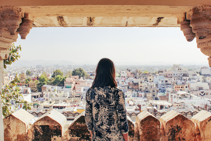 Woman overlooking a cityscape in India