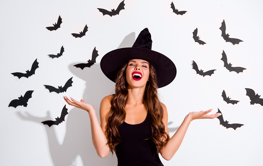 woman dressed as a witch with bats