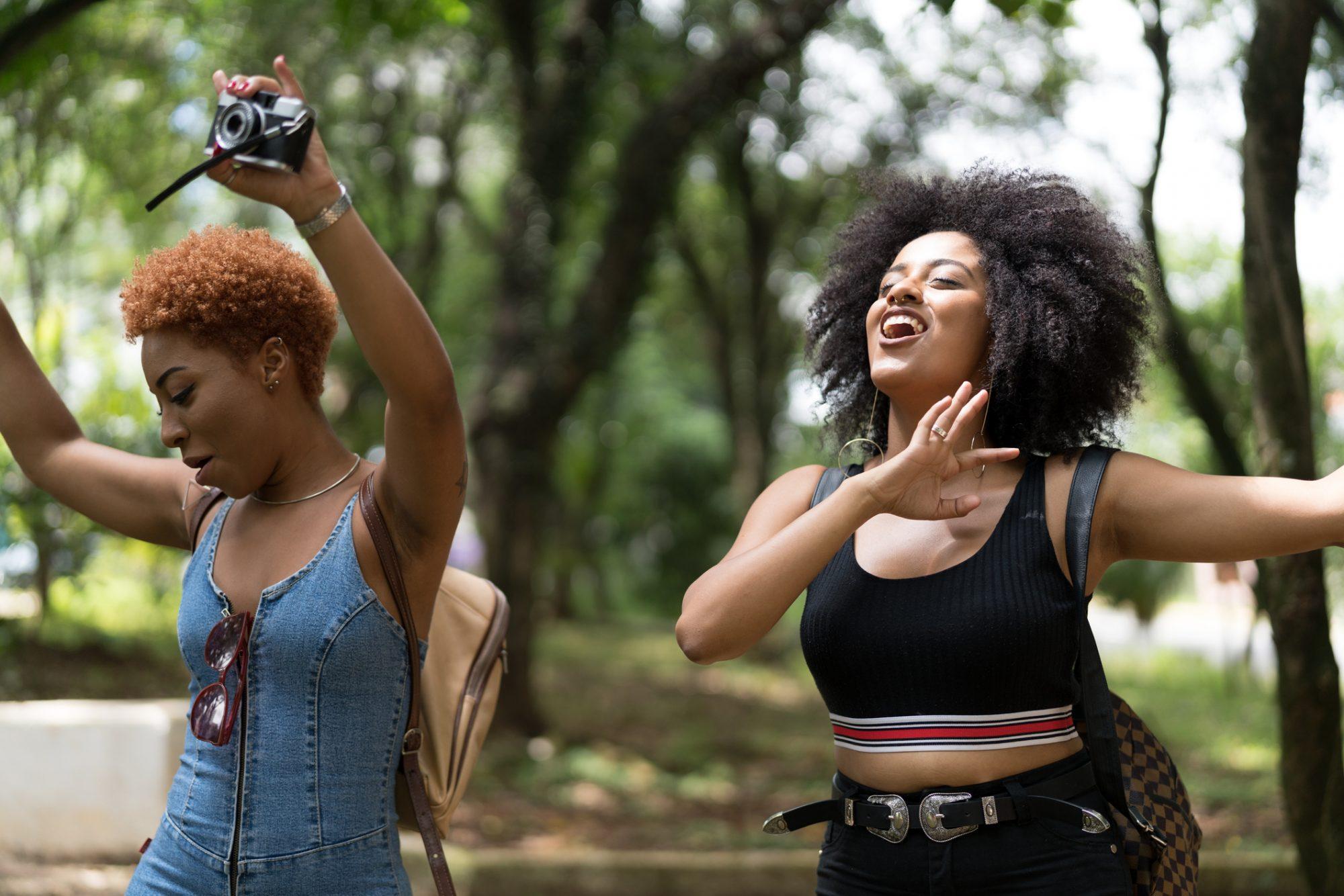 two happy women dancing