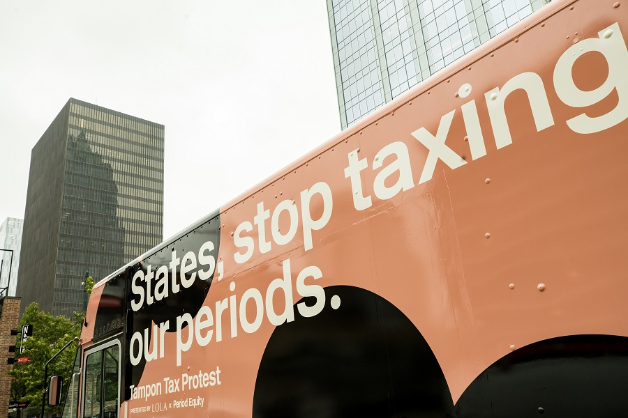 tampon tax protest van sign