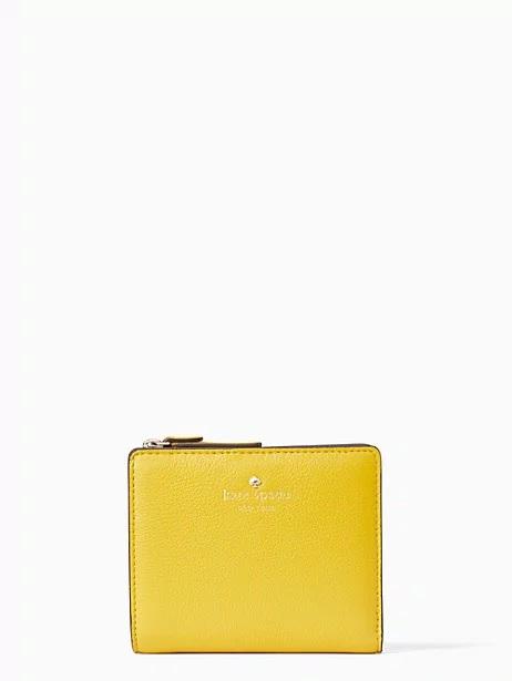 kate spade surprise sale on yellow wallet